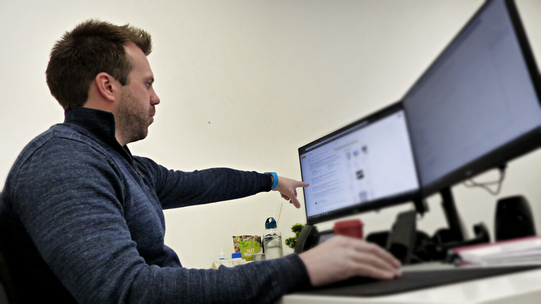 Image of Google Ads Specialist in front of two PC monitors